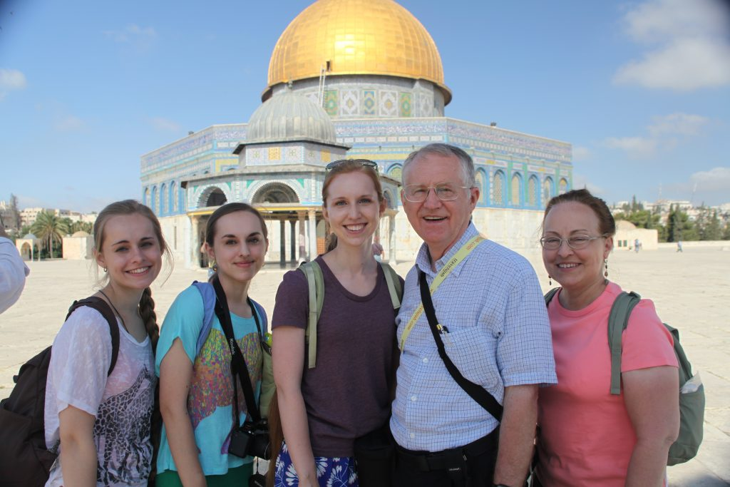 Family standing on the Temple Mount Plaza in front of the Dome of the Rock